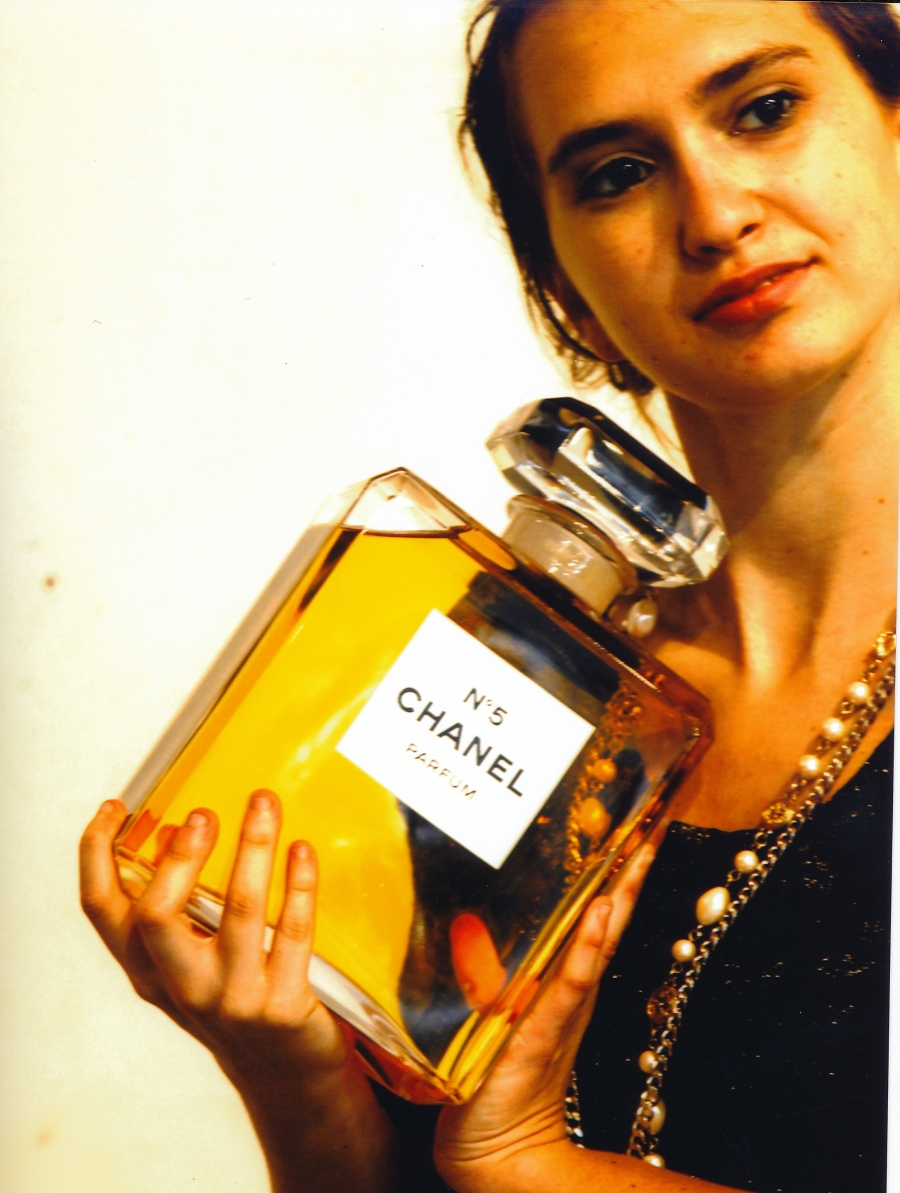 Coveting an oversize bottle of Chanel No. 5 Parfum. Top: YSL, necklaces: both Chanel. Photo credit: Peter Glebo.