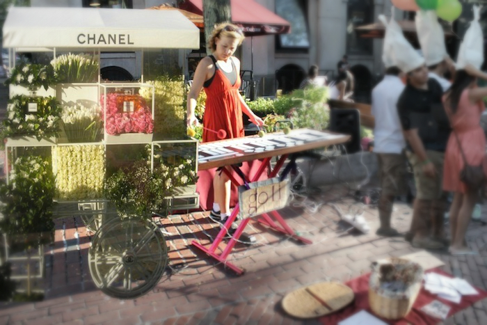 You know, it's possible this street performer at Quincy Market could be preoccupied with dreams of serenading Karl Lagerfeld with a private performance in Versailles.